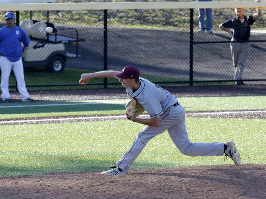 Arlington's Matt McGowan delivers a pitch against Horseheads on Thursday during a Class AA regional game at Maine-Endwell.