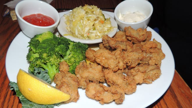 Fresh local oysters breaded and fried and served with delicious cole slaw reminiscent of kimchi is one of Hudson's many seafood specialties.