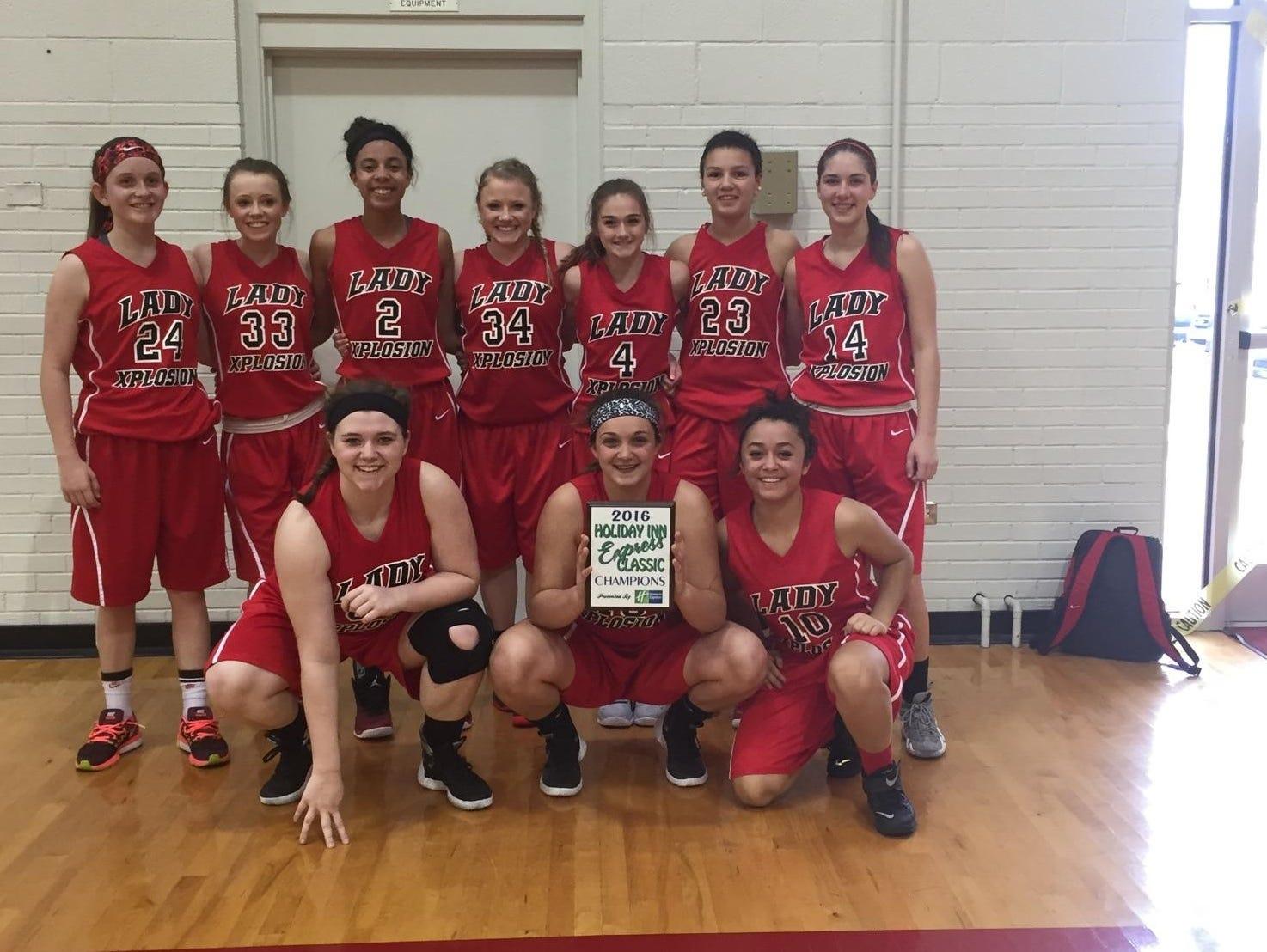 The Lady Xplosion 10th grade basketball team.