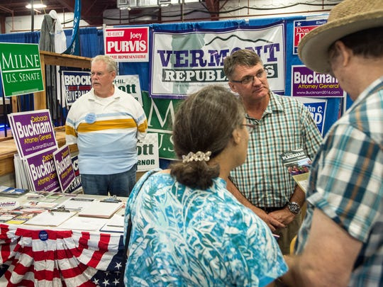 Center, House Minority Leader Rep. Don Turner, R-Milton, greets supporters at the Vermont Republican Party booth at the Champlain Valley Fair Thursday.
