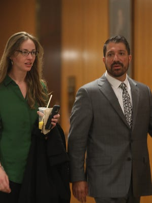 Catherine Bonner facing charges of menacing a police officer will have a bench trial.  She walks into her pre-trial hearing with her attorney, David Pilato.