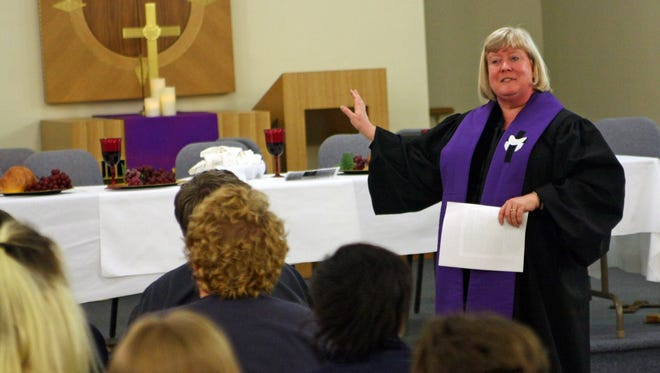 Pastor Lee Schott leads a service for Women at the Well Church in 2012.
