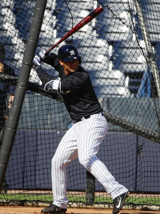 FILE - In this Feb. 17, 2017, file photo, New York Yankees' Gleyber Torres takes swings during a spring training baseball workout in Tampa, Fla. Torres, voted top player in the 2016 Arizona Fall League, will be given a chance to take over from Starlin Castro at second base for the Yankees. (AP Photo/Matt Rourke, File)