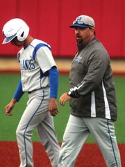 Highlands head coach Jeremy Baioni talks to a baserunner during Highlands baseball team's 6-0 win at Beechwood May 3, 2017 in Fort Mitchell KY