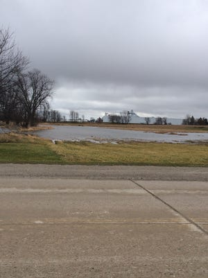 Water remains standing in this field just off M Avenue on the outskirts of Marengo Monday, Dec. 14.