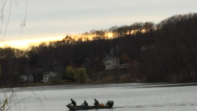 A rescue boat heads back to shore about 3:30 p.m. Sunday at White Meadow Lake, where multiple authorities were searching for a man who was missing after his canoe capsized about 3 a.m.