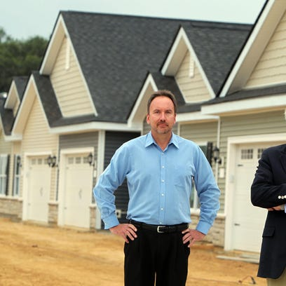Partners Ralph Meierjohan and T.J. Ackermann at their Hearth Home Communities apartment development in Harrison. Florence recently approved a similar development off Weaver Road. The development off Hopeful Church Road is currently under construction.
