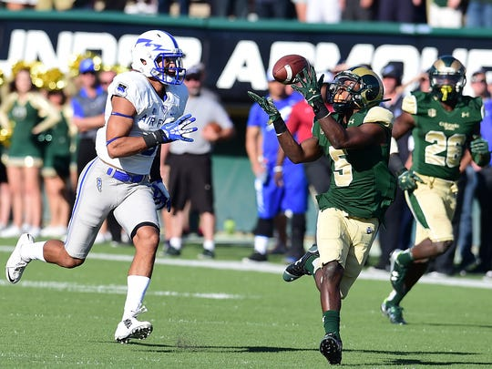 Cornerback Tyree Simmons, the only returning starter back in CSU's defensive secondary, intercepts a pass during a win over Air Force last season at Hughes Stadium.