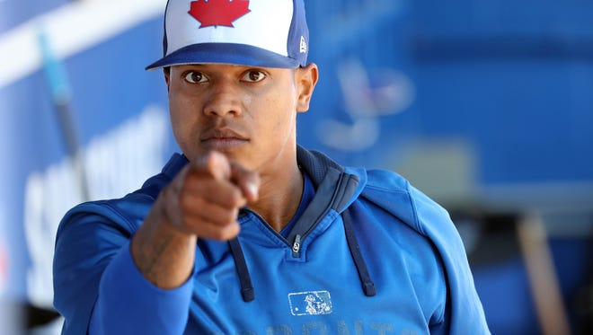 March 21: Blue Jays pitcher Marcus Stroman does his best Uncle Sam impression in the dugout during a spring-training game against the Phillies at Florida Auto Exchange Stadium in Dunedin, Fla.