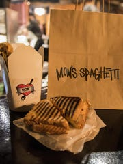 """Eminem's """"Mom's Spaghetti"""" pop-up shop sold merchandise and to-go containers of classic spaghetti, as well as spaghetti sandwiches."""