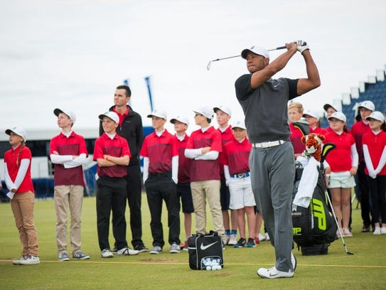 tiger woods gives five lucky juniors a day to remember at