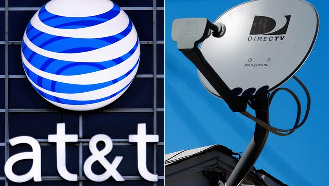 FILE - This file combo made from file photos shows the AT&T logo on the side of a corporate office in Springfield, Ill., left, and a DirecTV satellite dish atop a home in Los Angeles.