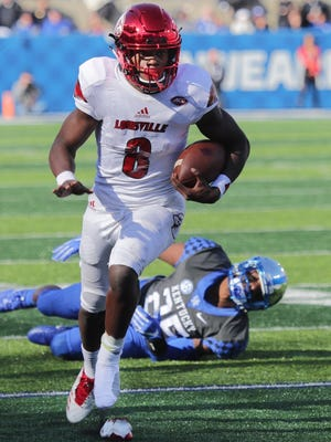 Lamar Jackson runs against Kentucky.