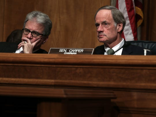Sen. Tom Carper (right) is pushing to close what he calls a loophole that allows for-profit colleges to exploit veterans.