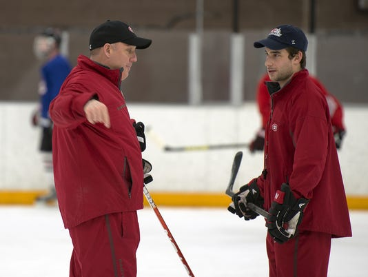 Up for coaching honor, Motzko is still 1 of the boys