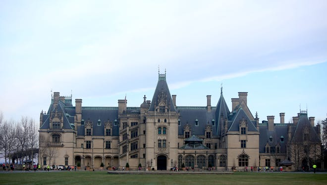 Runners pass by the Biltmore House during the Asheville Marathon and Half-Marathon, held on the grounds of the Biltmore Estate earlier this year.