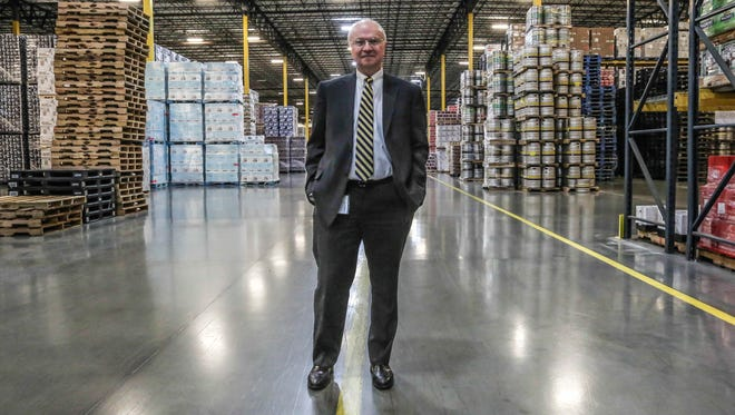 Phil Terry, CEO of Monarch Beverage, is shown here in the company's east side warehouse.