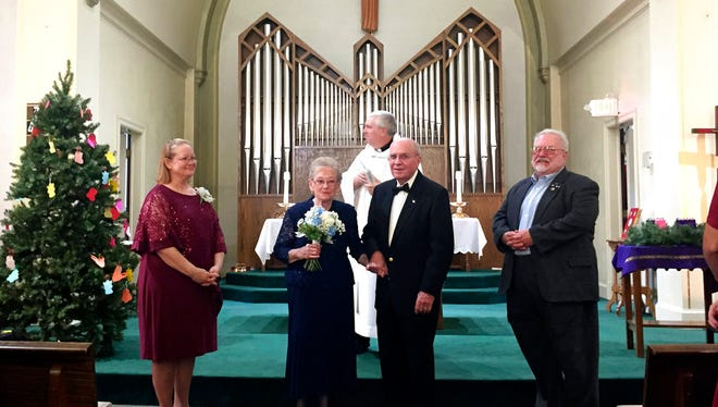 In this Saturday, Dec. 2, 2017 photo, Pat Mumme, 83, and Dale Eschilman, 89, center, were married, at SS Mary and Patrick Church in West Burlington, Iowa. The couple found love through an online dating site in Iowa.