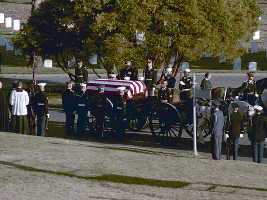 The casket carrying the body of President John F. Kennedy arrives at Arlington National Cemetery on Nov. 25, 1963.