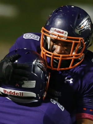 Eastlake running back Adrian Chavez was hoisted by teammate Hector Serrano after Chavez scored a touchdown late in the first half Thursday.