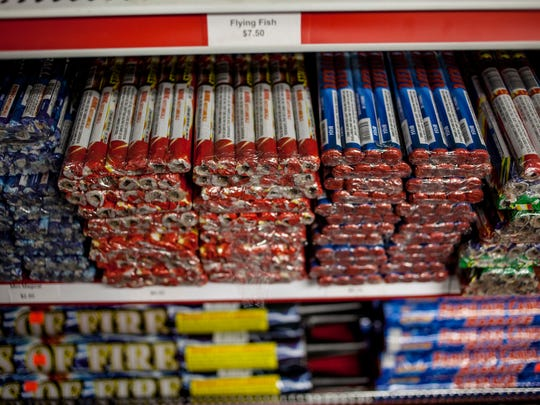 Dozens of fireworks are displayed on a shelf Thursday,