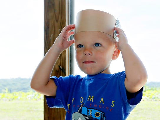 Tyler Nalesnik, 3, tries on his horns that were colored
