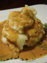 A perfect serving of mashed potatoes and gravy means