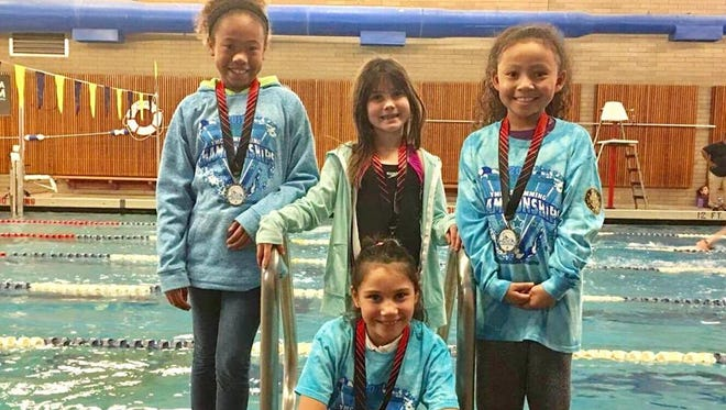 Bremerton YMCA's 100 free relay team of Yulia Farmer, Dominika Shelton, Aaliyah Green and Avari Harmon (not ordered) broke a 30-year team record at the YMCA regional championships last weekend in Corvallis, Oregon.