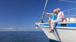 Senior couple on a sailboat