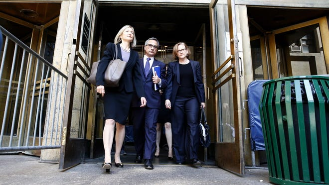 BNP Paribas lawyers leave the court in New York on June 30.