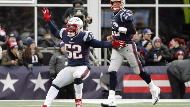 New England Patriots outside linebacker Elandon Roberts celebrates his touchdown reception from Tom Brady in last year's regular-season finale against the Dolphins.