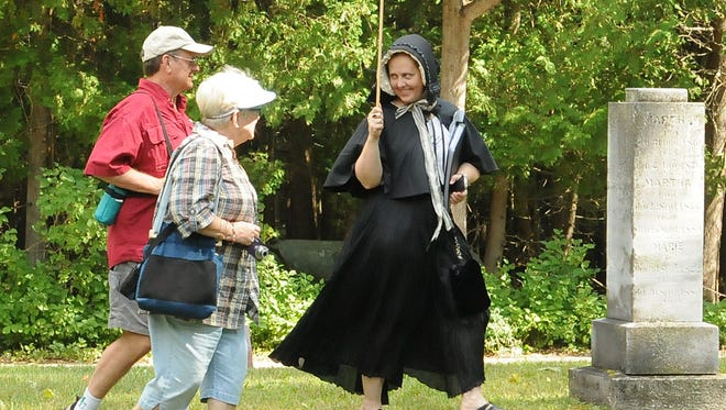 Ruth Oneson Mienke characterizes her ancester Katrina Oneson during the 2013 cemetery walk at Ephraim Moravian Cemetery.