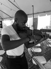 Heifetz student Wynton Grant practices on his violin