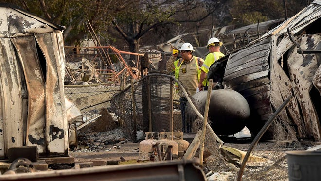 Southern California Edison workers from the Disaster Assessment Team inspect the electricity situation amid demolished South Lake homes in Lake Isabella, Calif., on June 25, 2016.