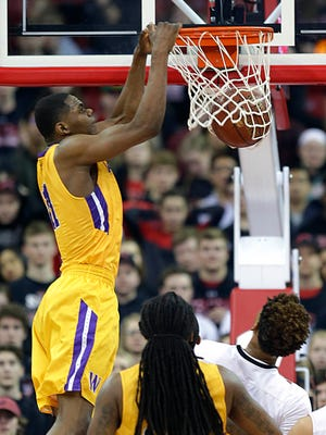 Milwaukee Washington's Michael Foster Jr. dunks against La Crosse Central  in a Division 2 semifinal game Friday in Madison.