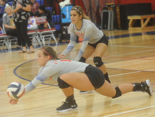 Cooper's Ellie McMillon stretches to dig a Wichita