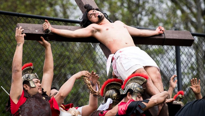 All Saints Catholic Parish's Hispanic community reenacts the final hours of Jesus Christ's life during a living Stations of the Cross on the parish grounds off Cedar Bluff Road in Knoxville on Friday, March 30, 2018.
