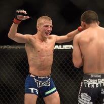 August 30, 2014; Sacramento, CA, USA; T.J. Dillashaw (red gloves) fights against Joe Soto (blue gloves) during the bantamweight title bout of UFC 177 at Sleep Train Arena. Mandatory Credit: Kyle Terada-USA TODAY Sports