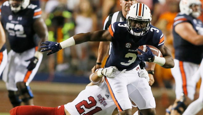 Auburn Tigers receiver Nate Craig-Myers (3) is tackled by Arkansas State Red Wolves safety Cody Brown (21) during the third quarter at Jordan Hare Stadium on Sep 10, 2016.