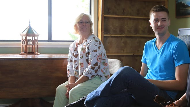 Theresa Mitchell and Rob Wilson listen to a fellow Quaker speak during a Sunday morning meeting of the Southern Utah Friends in September at the DiFiore Center in St. George.