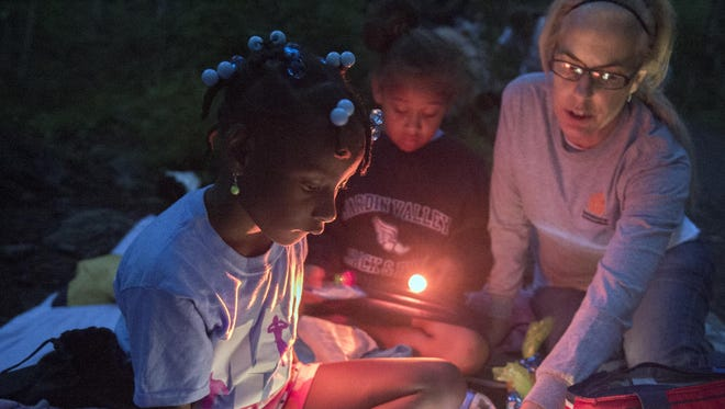 Youngsters camp out with adult mentors at a Big Brothers Big Sisters event in Tennessee. The South Jersey and Southeastern Pennsylvania chapters of the nonprofit have merged.