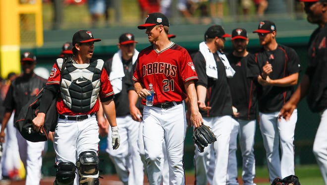 Arizona Diamondbacks pitcher Zack Greinke and Arizona Diamondbacks catcher Tuffy Gosewisch chat before the game as the Arizona Diamondbacks face off against the Seattle Mariners in spring training on Monday, March 14, 2016, at Salt River Fields at Talking Stick in Scottsdale, Ariz.  Diamondbacks beat the Mariners 8-3.
