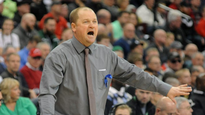 John Glenn's Greg Woodard yells onto the court during the Muskies' 84-56 victory over Bay Village on Thursday in the Division II state semifinals in Columbus. Woodard has coached the Muskies for 17 seasons.