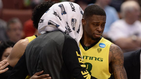 March 26, 2016; Anaheim, CA, USA; Oregon Ducks forward Elgin Cook (23) and forward Dwayne Benjamin (0) react during the 80-68 loss against Oklahoma Sooners in the West regional final of the NCAA Tournament at Honda Center. Mandatory Credit: Robert Hanashiro-USA TODAY Sports