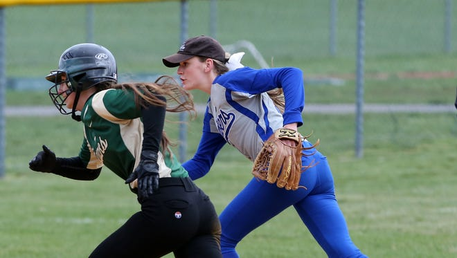 The Bombers of Sayreville take on the Hawks of J.P. Stevens High School in a girls softball in Edison on Friday April 8, 2016.J.P. Steven's # 8 -Kayla Smith (left) is paced by Sayreviile's # 17- Ryan Brush as Smith heads to 3rd base on a hit and run play.