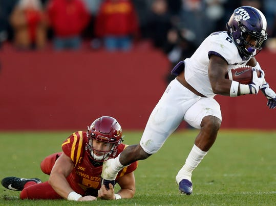 TCU running back Darius Anderson runs from Iowa State linebacker Joel Lanning, left, during the second half of an NCAA college football game, Saturday, Oct. 28, 2017, in Ames, Iowa. Iowa State won 14-7. (AP Photo/Charlie Neibergall)