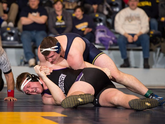 Michigan's Adam Coon takes down a Northwestern competitor on Jan. 29 in Ann Arbor.