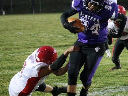 Mescalero's Sabastian Chino, right, breaks free from a Springer defender.