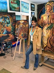 Local artist Kathleen Cotton held her first art exhibition in three-and-a-half years Saturday at Art Ruidoso Gallery.