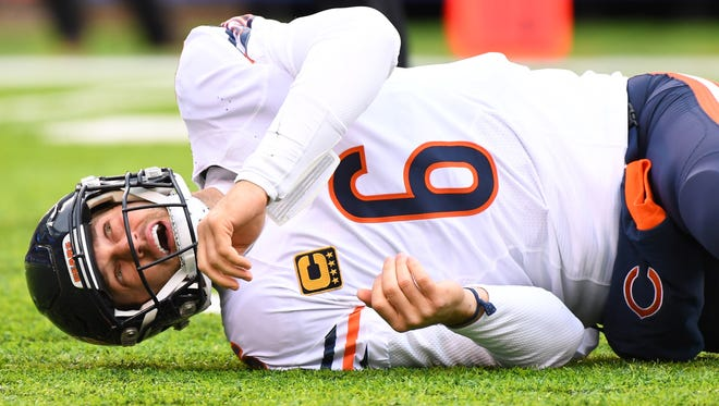 Bears quarterback Jay Cutler (6) lays on the field after a hit Sunday.